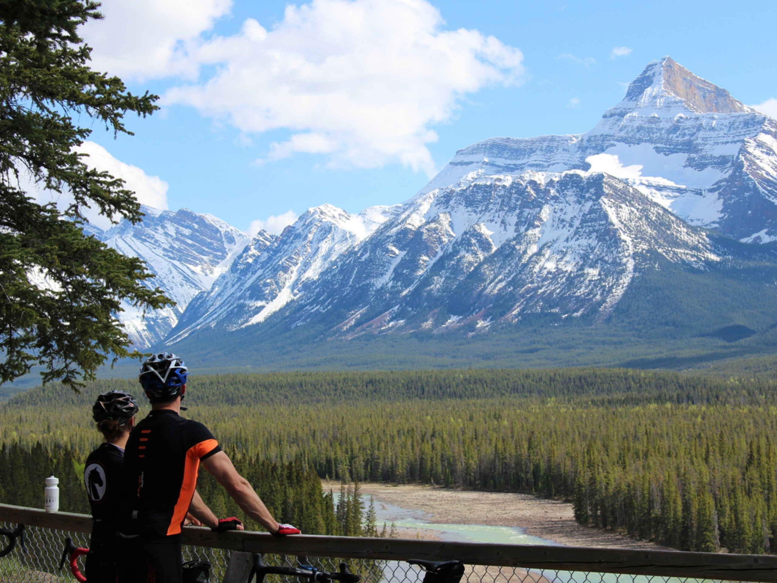 Two bikers observing the beautiful views of the Alberta wilderness