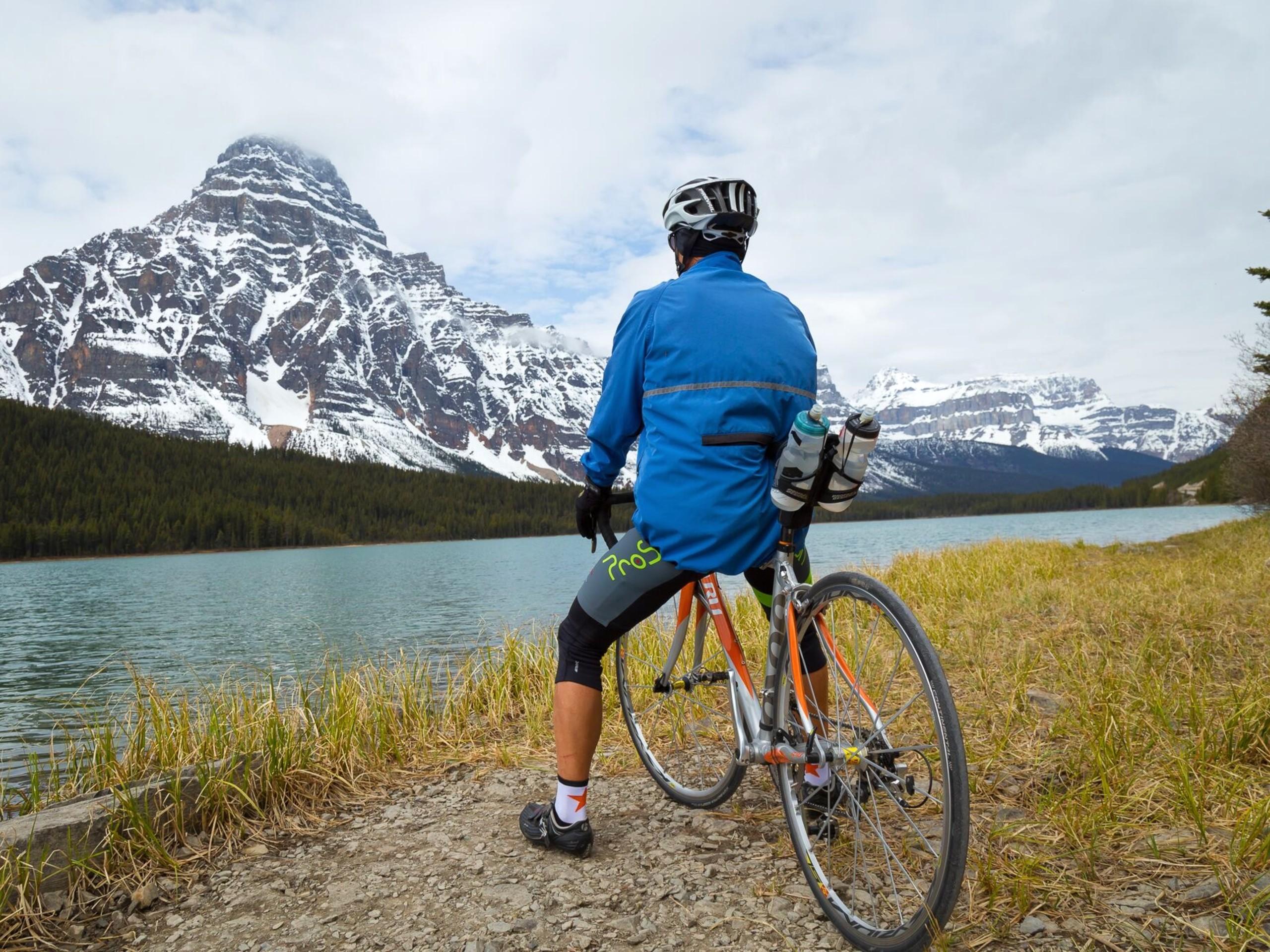 Biker observing the beautiful views near the river in Alberta