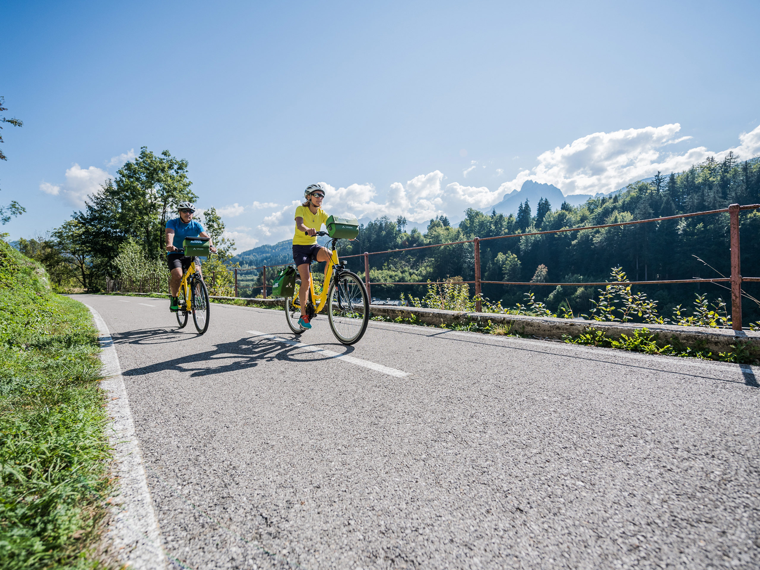 Two tourists on a road cycling trip on AlpeAndria