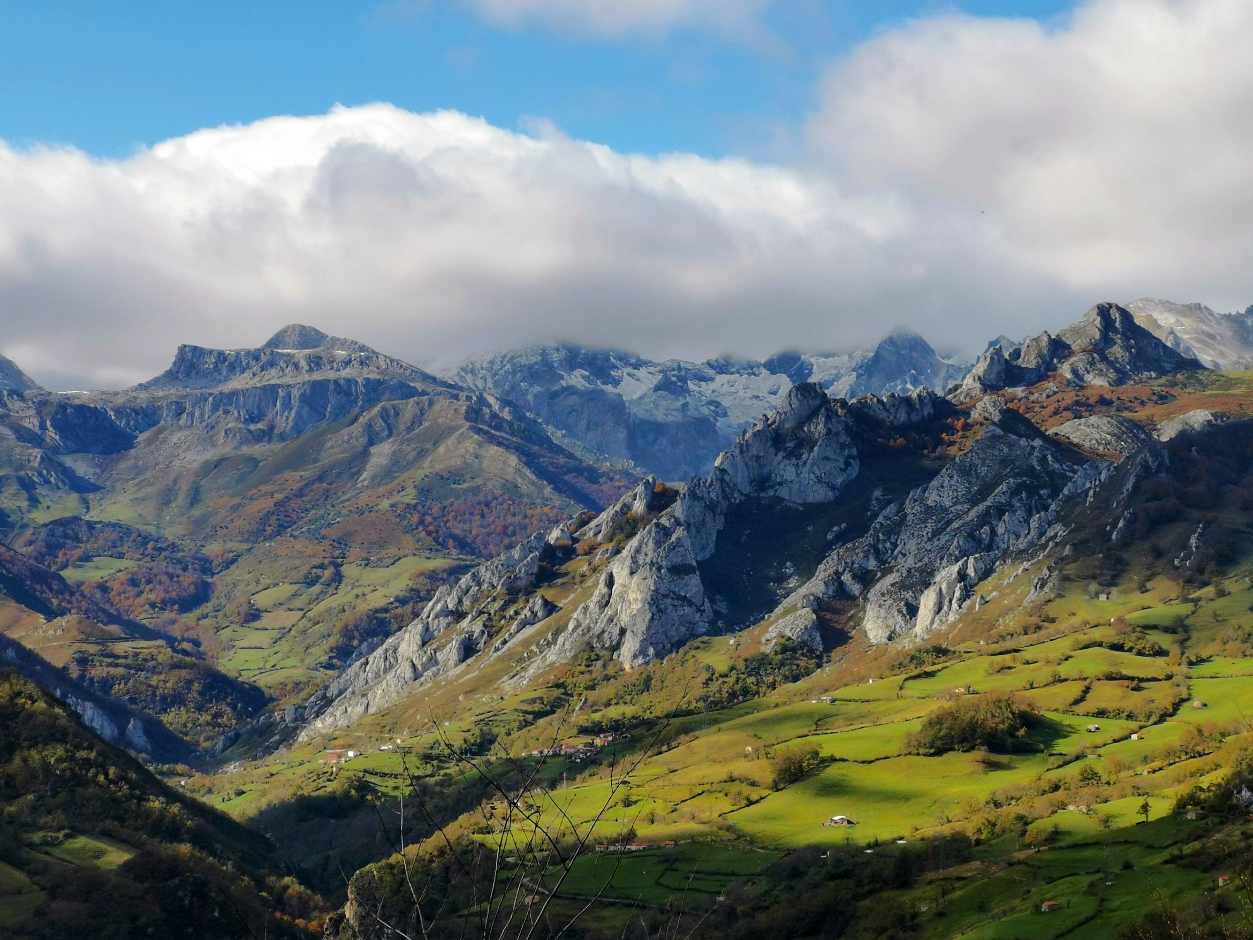 Looking at the green valley in Picos de Europa (Spain) while on family tour