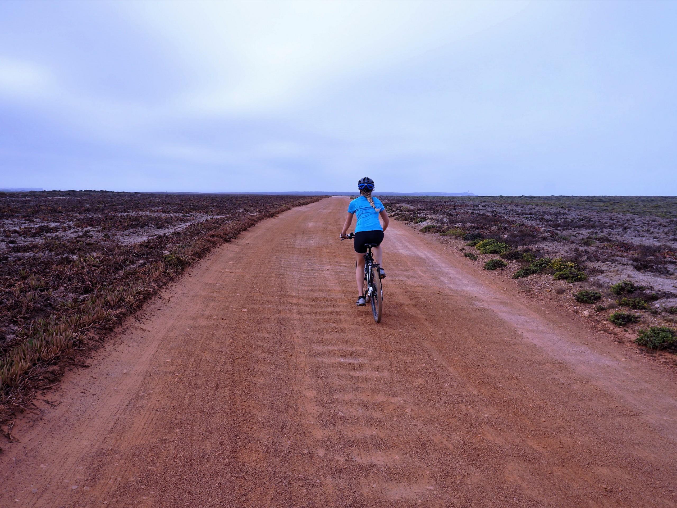 Biker riding on the gravel roads near Algarve