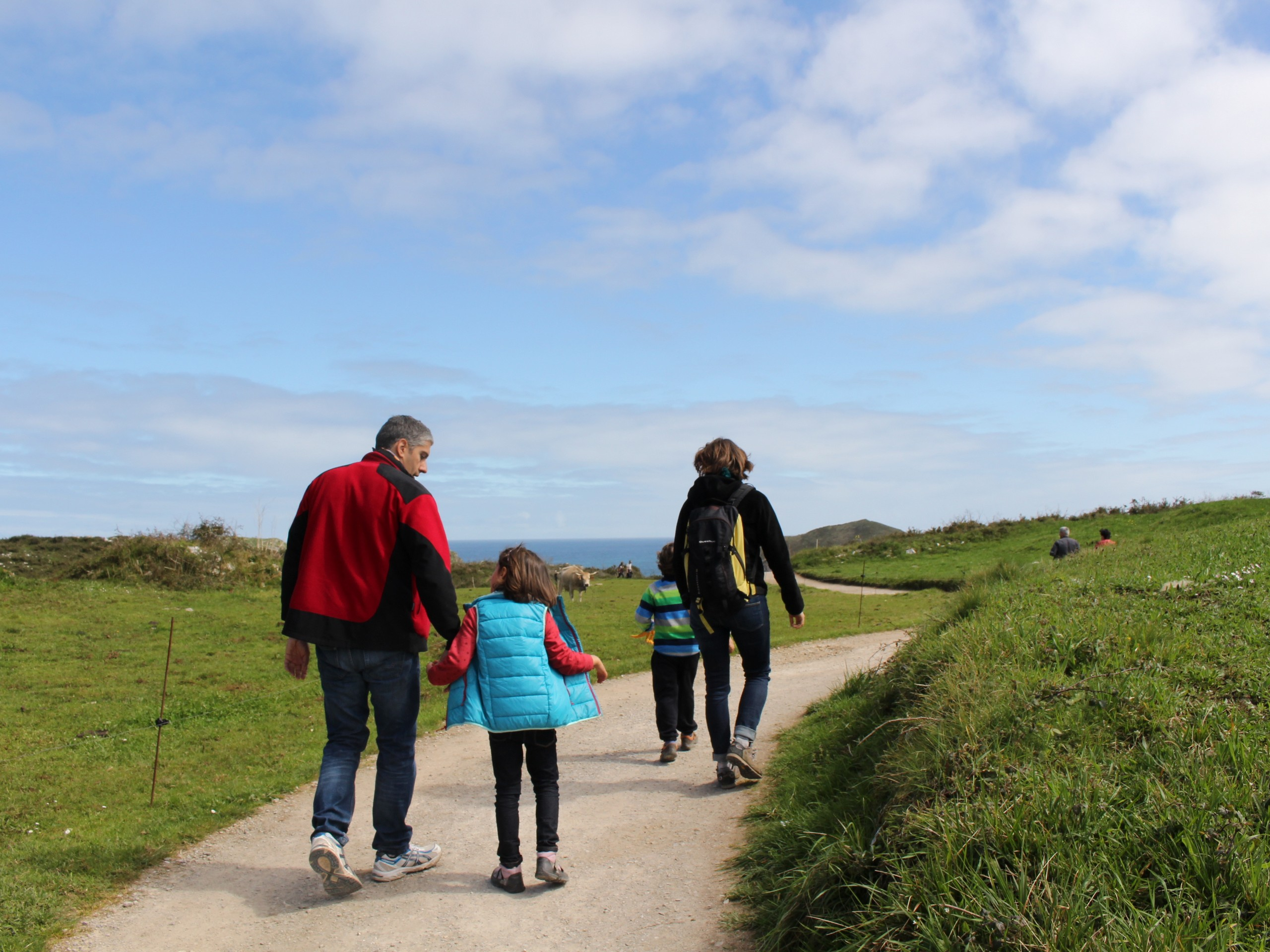 Family walking the coastal path in Portugal