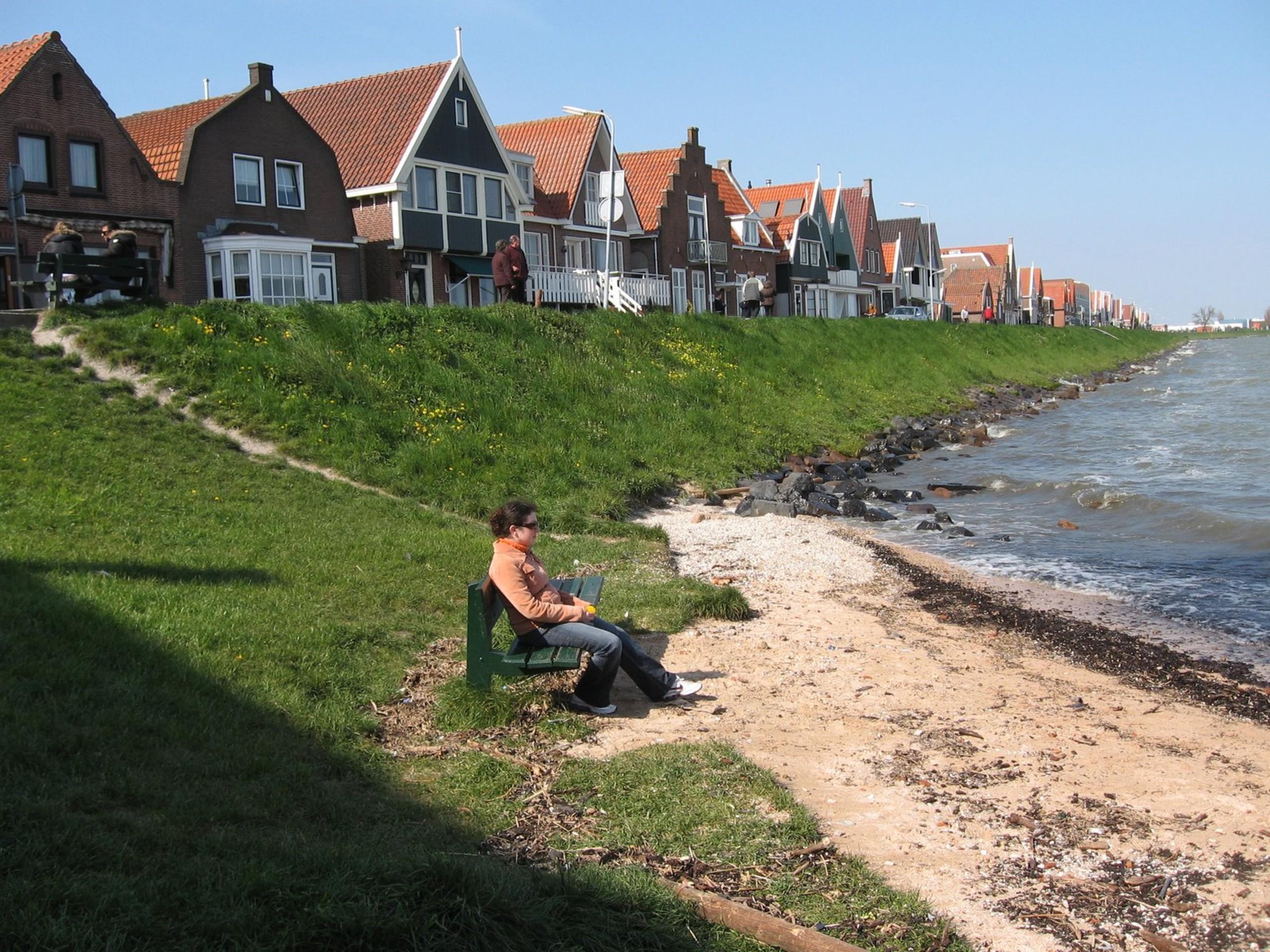 Lady reading a book near the coast of Volendam