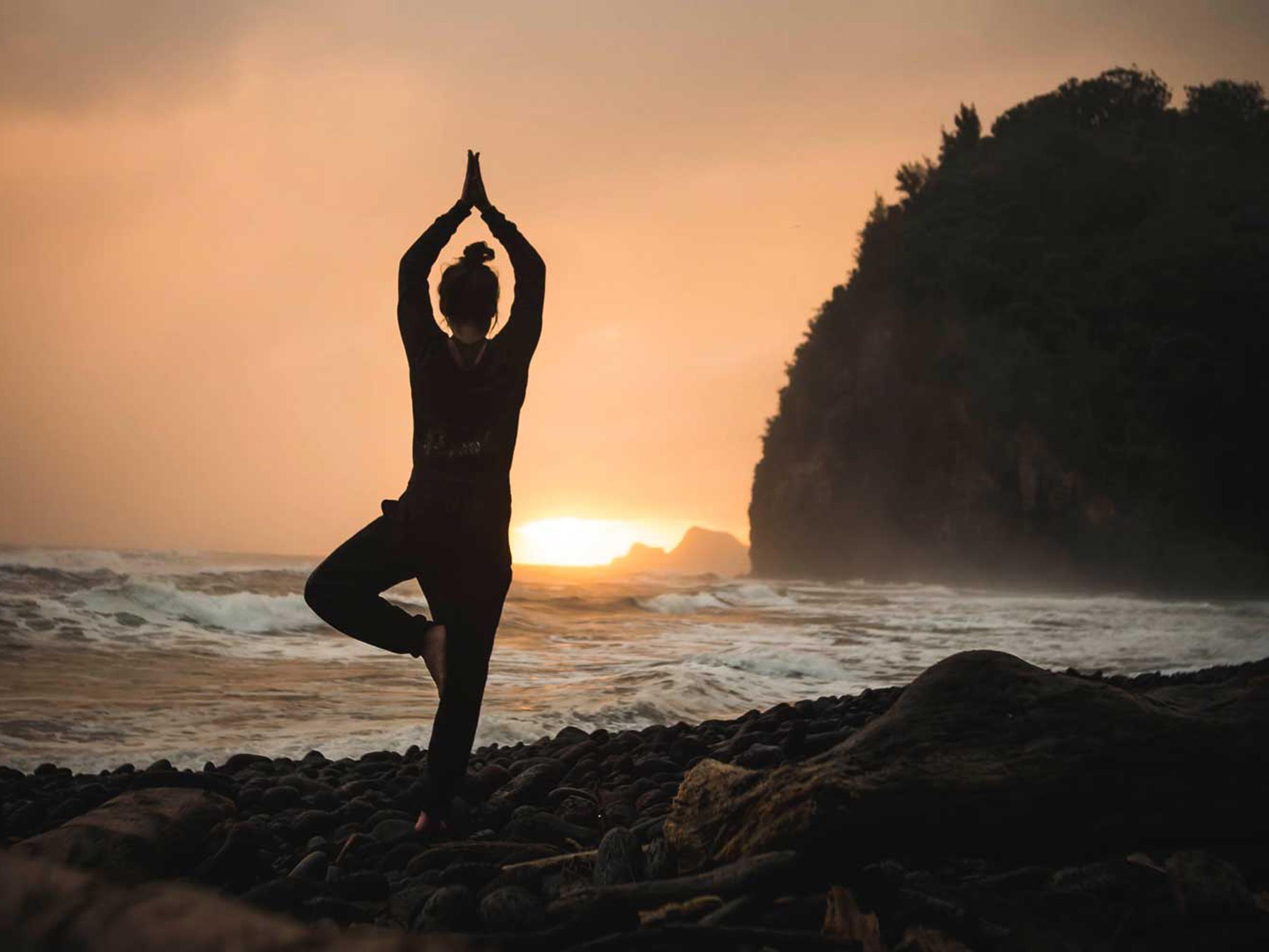Sunset yoga on the coast