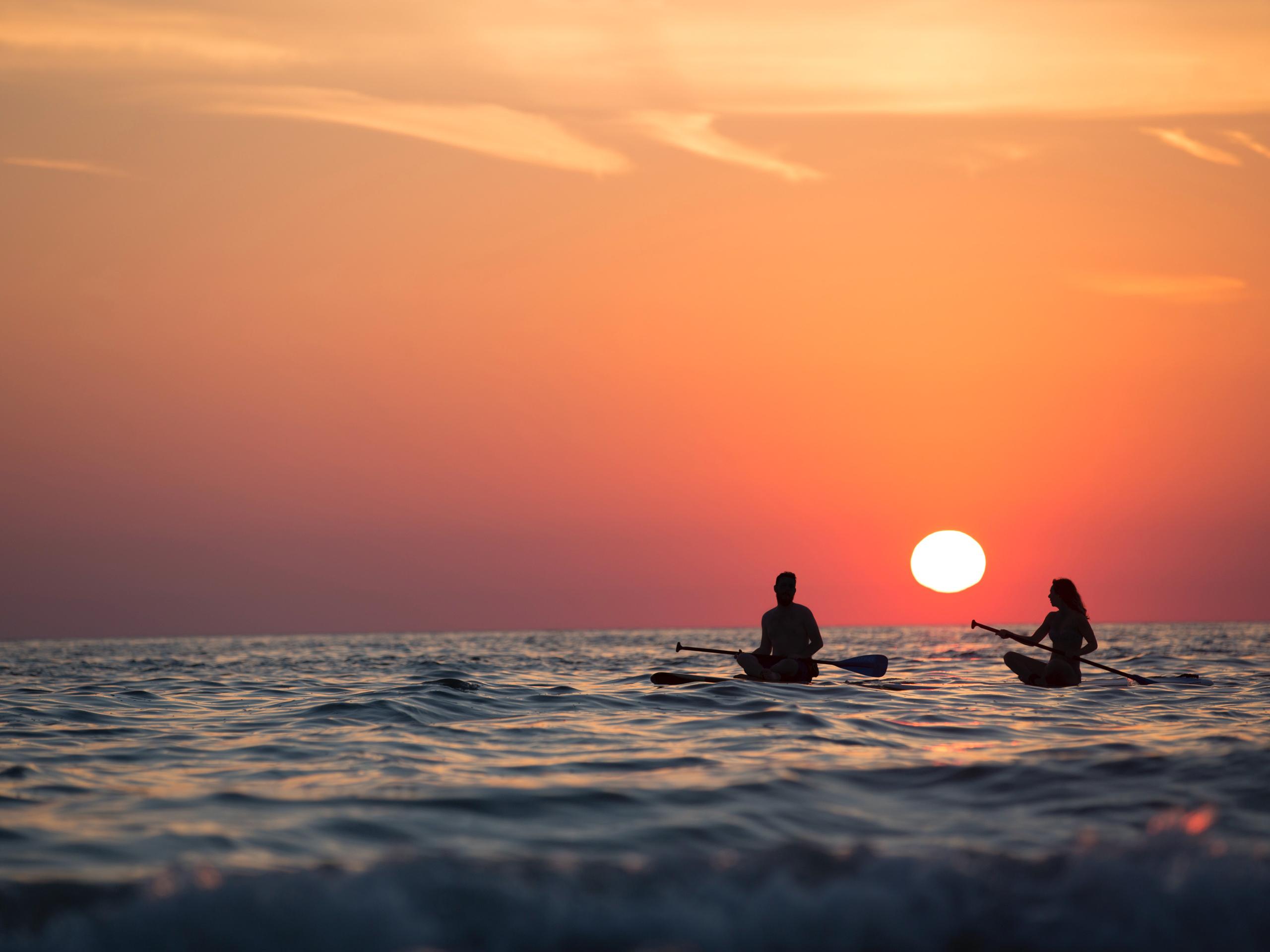 Sea sunset paddleboard