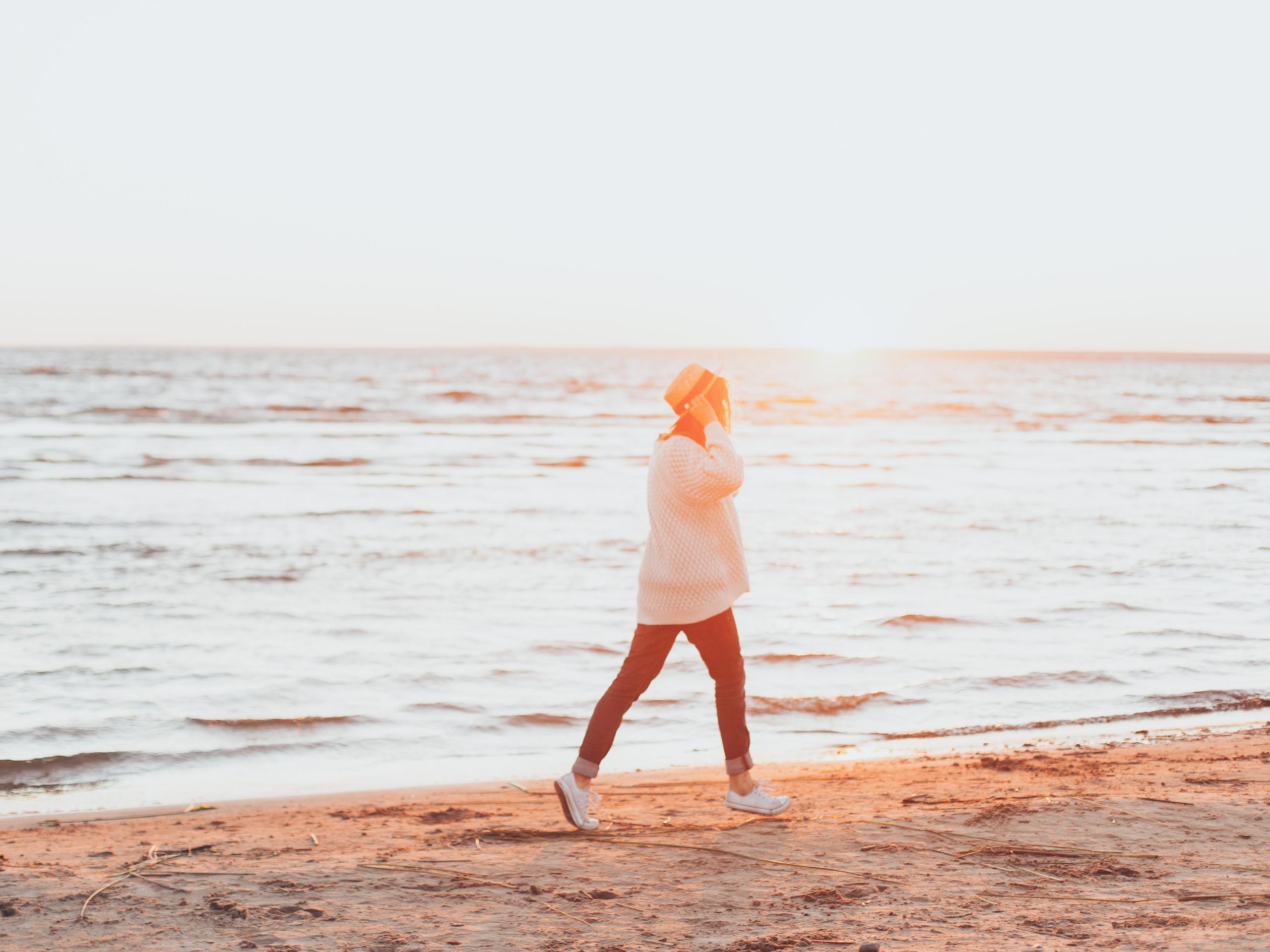 Girl walks on the beach in Tofino