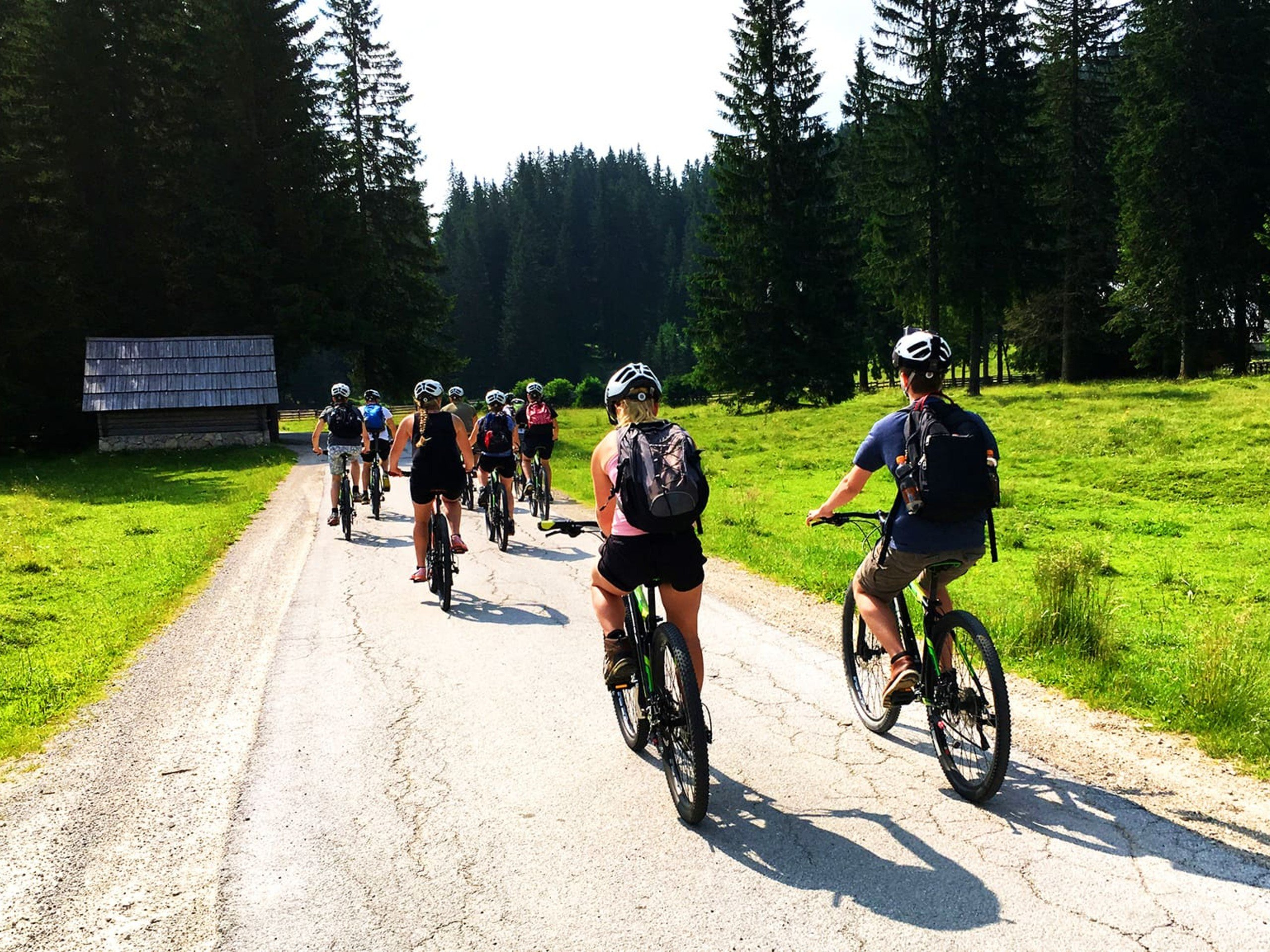 Group of cyclists riding the gravel road in Slovenia