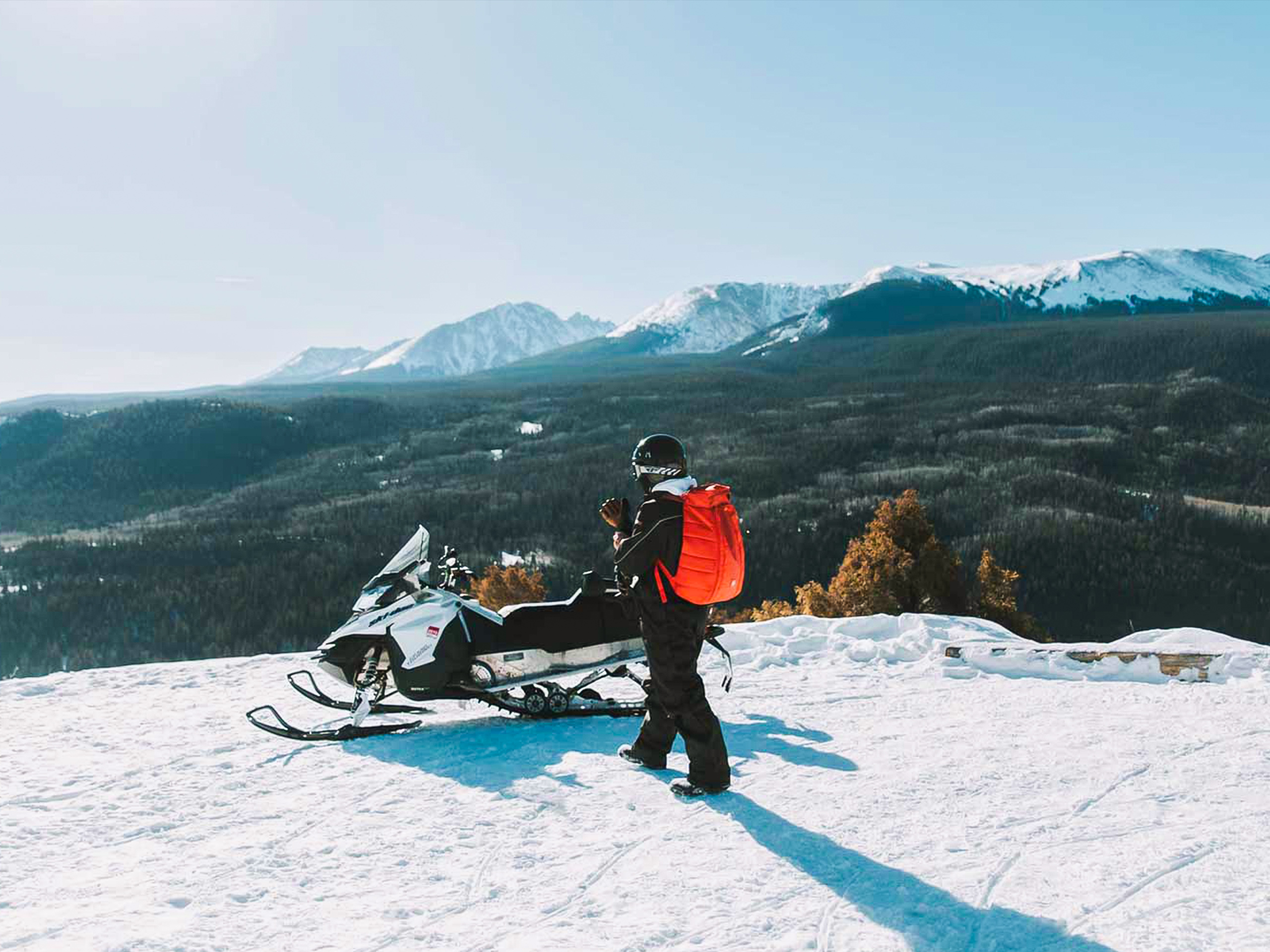 Snowmobile and Mountains Landscape