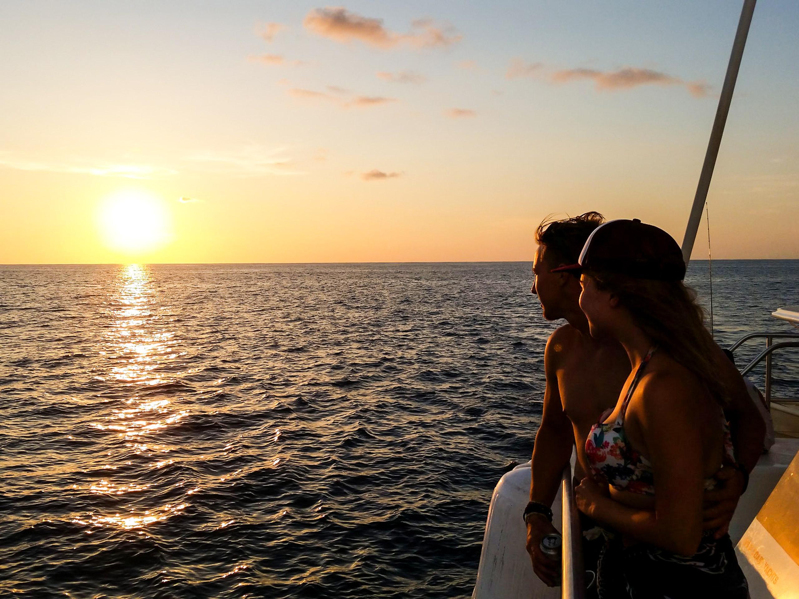 Sunset lights sea walking on the catamaran